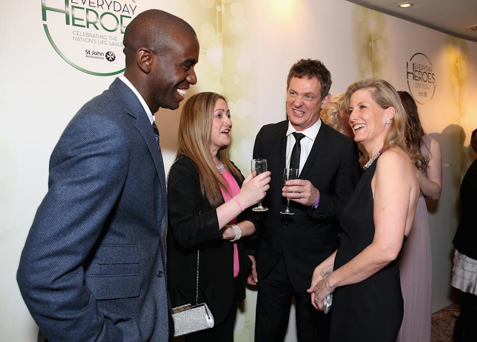 LONDON, ENGLAND - MARCH 26: Sophie, Countess of Wessex (R) greets Fabrice Muamba, Amelia Wright and Matthew Wright as they attend the star-studded St John Ambulance Everyday Heroes celebration of the nation's life savers at the Royal Lancaster Hotel on March 26, 2014 in London, England. (Photo by Mike Marsland/WireImage for St John Ambulance)