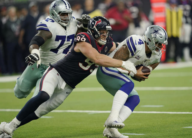 FILE - In this Oct. 7, 2018, file photo, Dallas Cowboys quarterback Dak Prescott (4) is sacked by Houston Texans defensive end J.J. Watt (99) during the second half of an NFL football game, in Houston. The Buffalo Bills take on the Texans in Houston on Sunday. Watt is tied for first in the NFL with six sacks this year. (AP Photo/David J. Phillip, File)
