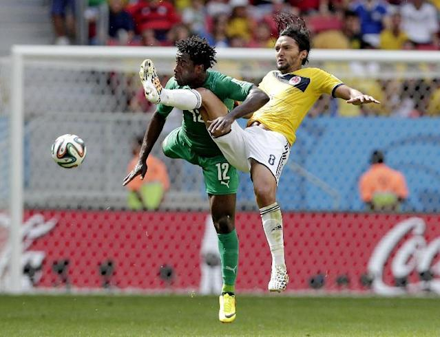 Ivory Coast's Wilfried Bony (12) and Colombia's Abel Aguilar (8) battle for the ball during the group C World Cup soccer match between Colombia and Ivory Coast at the Estadio Nacional in Brasilia, Brazil, Thursday, June 19, 2014. (AP Photo/Marcio Jose Sanchez)