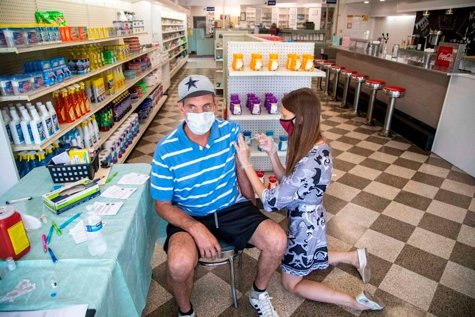 Dr. Stephanie Bellows prepares to administer a COVID-19 vaccine to Earl Nealy, 59, at Guiton's Drug Store in Whieville Thursday, July 29, 2021. Columbus County has the state's highest rate for COVID-19 and one of the lowest for vaccinations. Dr. Bellows vaccinated 38 people on Thursday.