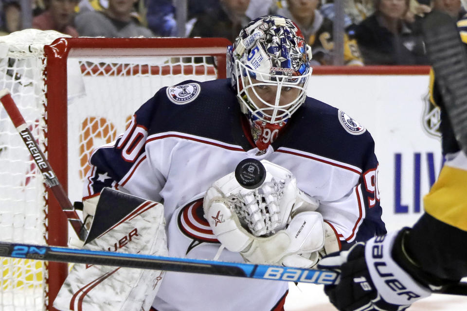 Columbus Blue Jackets goaltender Elvis Merzlikins watches the puck during the second period of an NHL hockey game against the Pittsburgh Penguins in Pittsburgh, Saturday, Oct. 5, 2019. (AP Photo/Gene J. Puskar)
