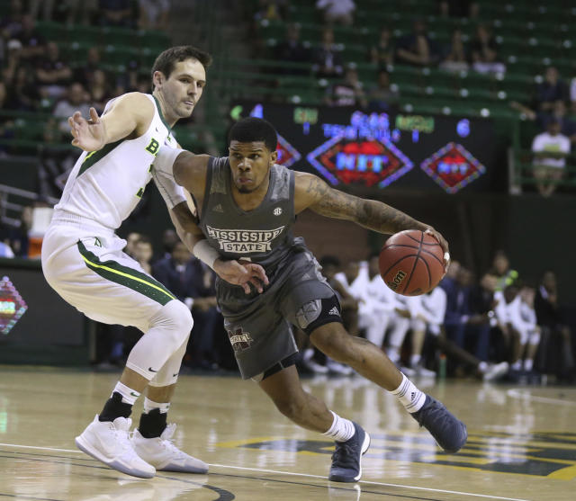 Mississippi State guard Lamar Peters, right, drives on Baylor guard Jake Lindsey, left, during the first half of an NCAA college basketball game in the second round of the NIT tournament, Sunday, March 18, 2018, in Waco, Texas. (Rod Aydelotte/Waco Tribune-Herald via AP)