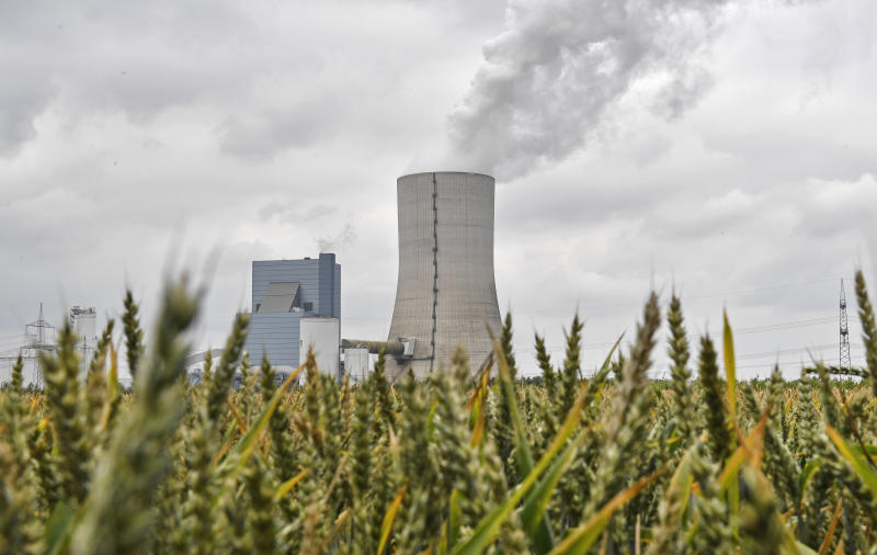 The controversial most modern Uniper Datteln 4 coal-powered plant steams behind a corn field one month after the operational start in Datteln, Germany, Friday, July 3, 2020. The state governors Dietmar Woidke of Brandenburg, Michael Kretschmer of Saxony, Reiner Haseloff of Saxony-Anhalt and Armin Laschet of North Rhine-Westphalia meet in Berlin for the adoption by the Bundestag and Bundesrat of the laws on coal phase-out and structural strengthening in the affected federal states. (AP Photo/Martin Meissner)