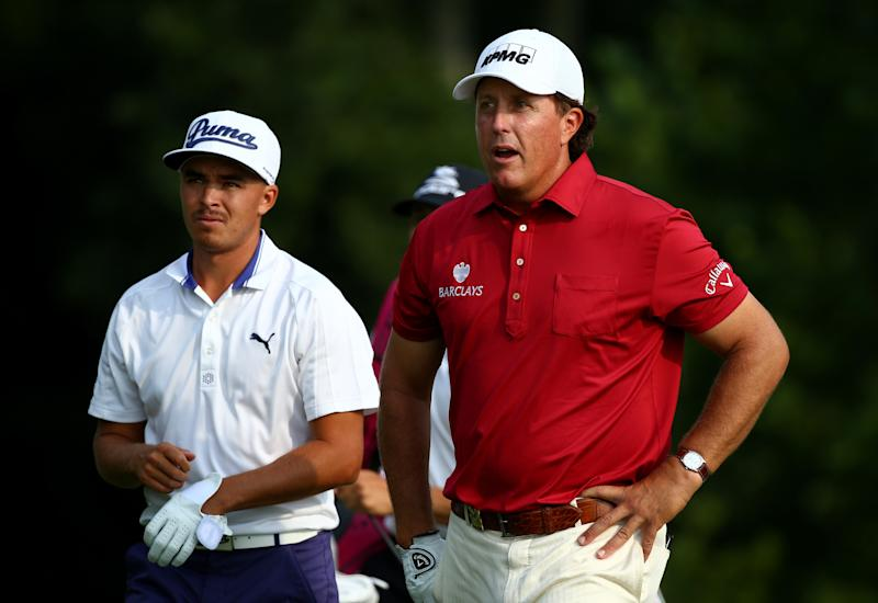(L-R) Rickie Fowler of the United States and Phil Mickelson of the United States look on at Valhalla Golf Club on August 5, 2014 in Louisville, Kentucky