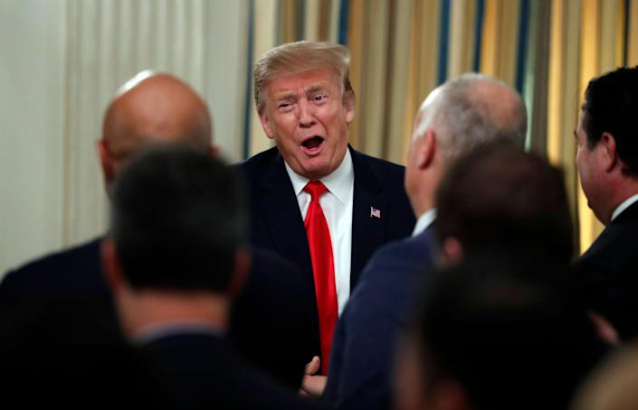 President Donald Trump speaks to the National Association of Attorneys General, Monday, March 4, 2019, in the State Dining Room of the White House in Washington. (AP Photo/Jacquelyn Martin)