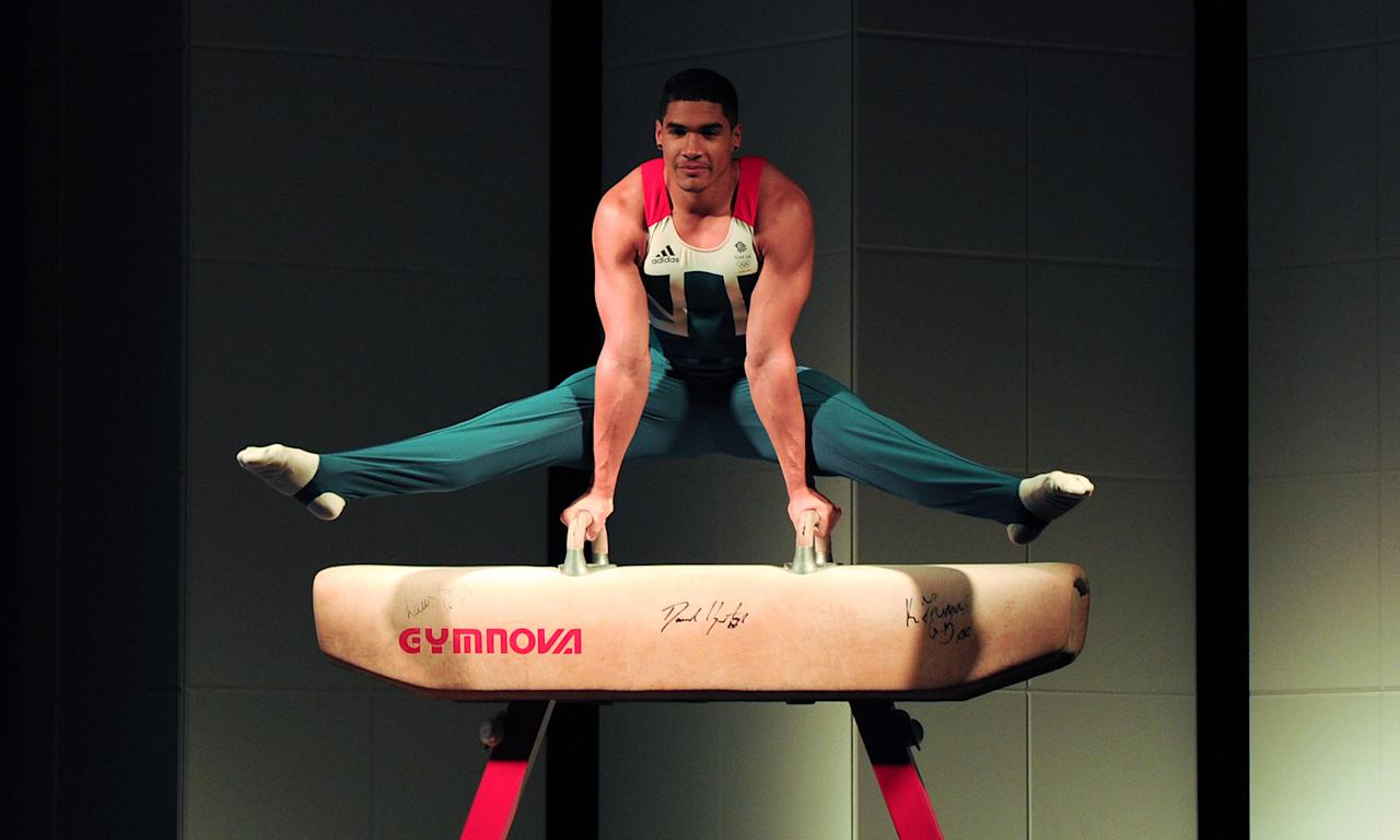 British gymnast Louis Smith athletes poses on a pommel horse in the newly unveiled British Olympic Team GB kit designed by Stella McCartney during a photocall in central London on March 22, 2012. AFP PHOTO / CARL COURT (Photo credit should read CARL COURT/AFP/Getty Images)