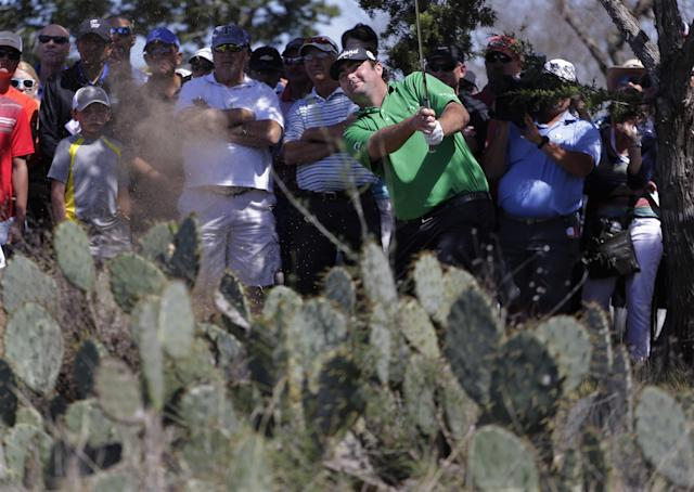 Steven Bowditch, of Australia, hits out of the rough behind cactus in the second hole during the final round of the Texas Open golf tournament on Sunday, March 30, 2014, in San Antonio. (AP Photo/Eric Gay)