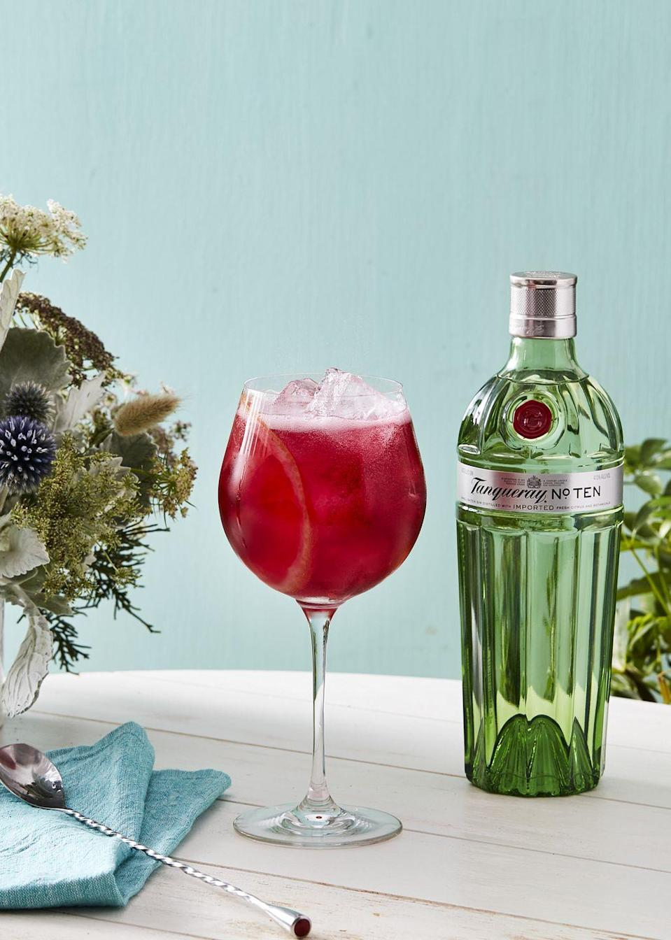 <p>Mixologist Lauren Davis' take on a traditional spritz involves a gorgeous and vibrant hibiscus syrup to liven up cocktail hour. Plus, we always love an excuse to use a bold and botanical-forward gin.</p><p><strong> Ingredients:</strong></p><p>1 1/2 ounces Tanqueray No.Ten (or other London dry gin)</p><p>3/4 ounces hibiscus syrup (recipe below)</p><p>club soda</p><p>grapefruit wheel, for garnish</p><p><strong>Directions:</strong></p><ol><li>Make the hibiscus syrup by steeping 1-2 bags of hibiscus tea in a cup of hot water. Remove the tea bags after five minutes and add one cup of sugar. Stir until the sugar is dissolved.</li><li>Add gin and hibiscus syrup to a copa or wine glass. Add ice. Top with club soda and garnish with a grapefruit wheel.</li></ol>