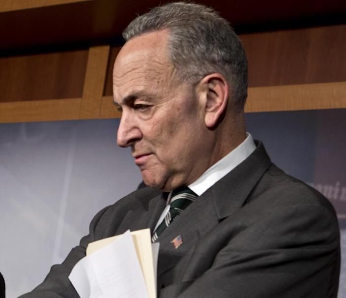 FILE - In this Jan. 28, 2013 file photo, Sen. Charles Schumer, D-N.Y. listens during a news conference on Capitol Hill in Washington. A divided Senate Judiciary Committee approved a Democratic bill Tuesday expanding required federal background checks to nearly all gun purchases, giving President Barack Obama an early victory on curbing gun violence in a fight that still faces difficult odds. The vote was 10-8, with all Democrats supporting the measure and every Republican opposing it. (AP Photo/J. Scott Applewhite)