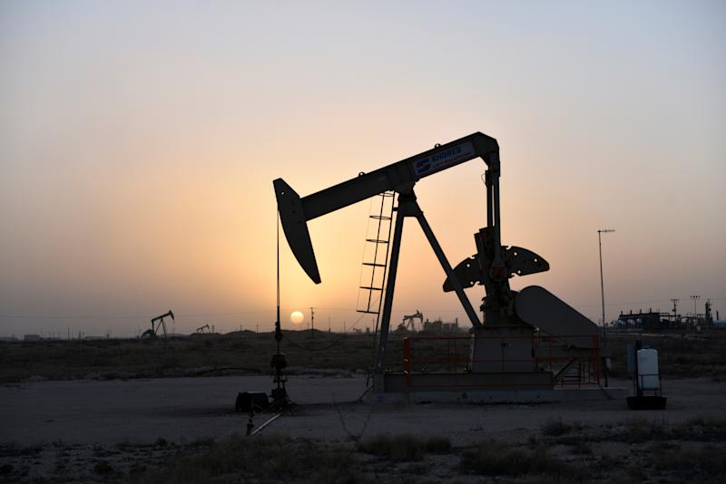 Pump jacks operate at sunset in Midland, Texas U.S. February 11, 2019. Picture taken February 11, 2019. REUTERS/Nick Oxford