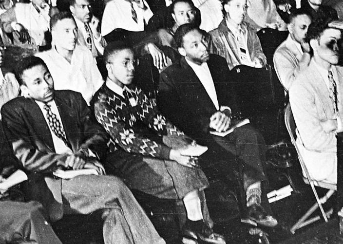 <p>Martin Luther King, Jr., third from left, listens to a speaker during an assembly at Morehouse College in Atlanta. As a teenager in 1944, King worked on a tobacco farm in Connecticut. That experience influenced his decision to become a minister. (AP Photo) </p>