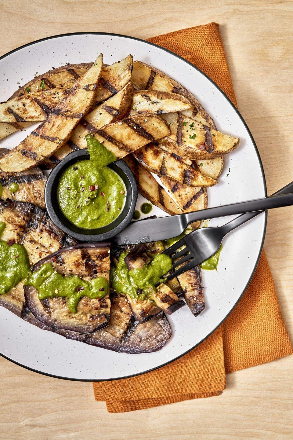 """<p>An Argentine herb sauce, chimichurri, transform eggplants and potatoes from vegetable sides to a complete, fancy dinner.</p><p>Get the recipe from <a href=""""https://www.delish.com/cooking/recipe-ideas/a36973006/eggplant-steak-with-chimichurri/"""" rel=""""nofollow noopener"""" target=""""_blank"""" data-ylk=""""slk:Delish"""" class=""""link rapid-noclick-resp"""">Delish</a>.</p>"""