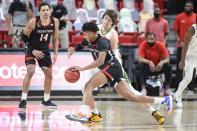 Texas Tech's Terrence Shannon Jr. (1) dribbles the ball against Baylor's Matthew Mayer (24) during the second half of an NCAA college basketball game in Lubbock, Texas, Saturday, Jan. 16, 2021. (AP Photo/Justin Rex)