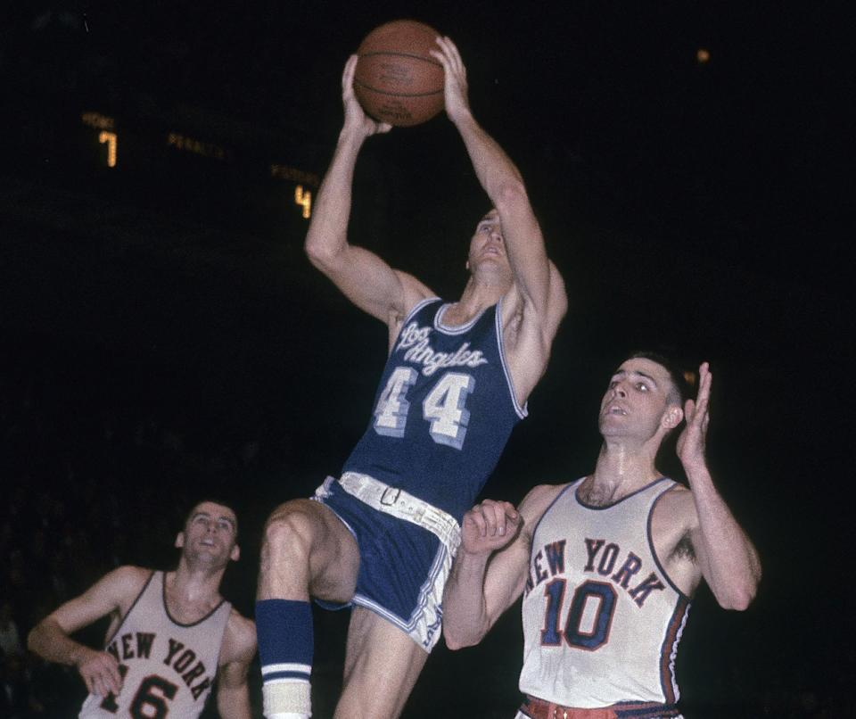 Jerry West goes up for a shot in front of Dave Budd and Mel Peterson of the New York Knicks at Madison Square Garden. (Focus on Sport/Getty Images)