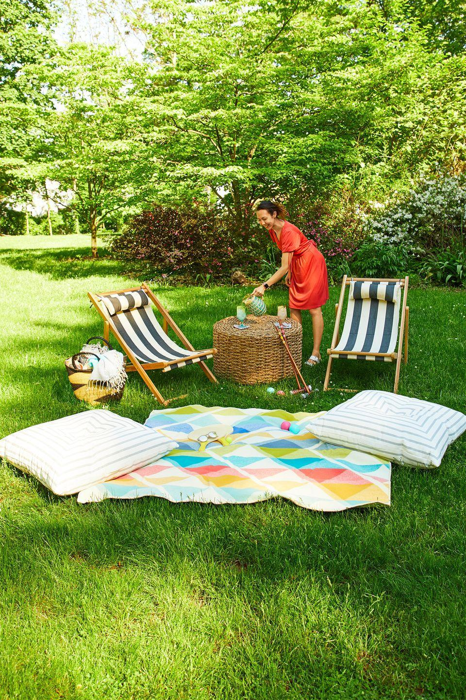 """<p>Since lawn furniture may be too bulky to suit the size of your space, go for folding chairs that can be stored easily when they're not in use. For a warm and inviting vibe, throw an outdoor rug and floor pillows on the surrounding grass. </p><p><strong>RELATED: </strong><a href=""""https://www.goodhousekeeping.com/home-products/g27257593/best-outdoor-furniture/"""" rel=""""nofollow noopener"""" target=""""_blank"""" data-ylk=""""slk:The Best Outdoor Furniture You Can Buy"""" class=""""link rapid-noclick-resp"""">The Best Outdoor Furniture You Can Buy </a></p>"""