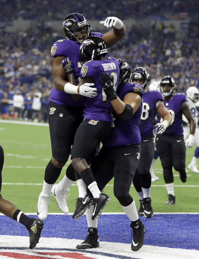 Baltimore Ravens wide receiver John Brown (13) celebrates a touchdown catch with teammates against the Indianapolis Colts in the first half of an NFL preseason football game in Indianapolis, Monday, Aug. 20, 2018. (AP Photo/Darron Cummings)