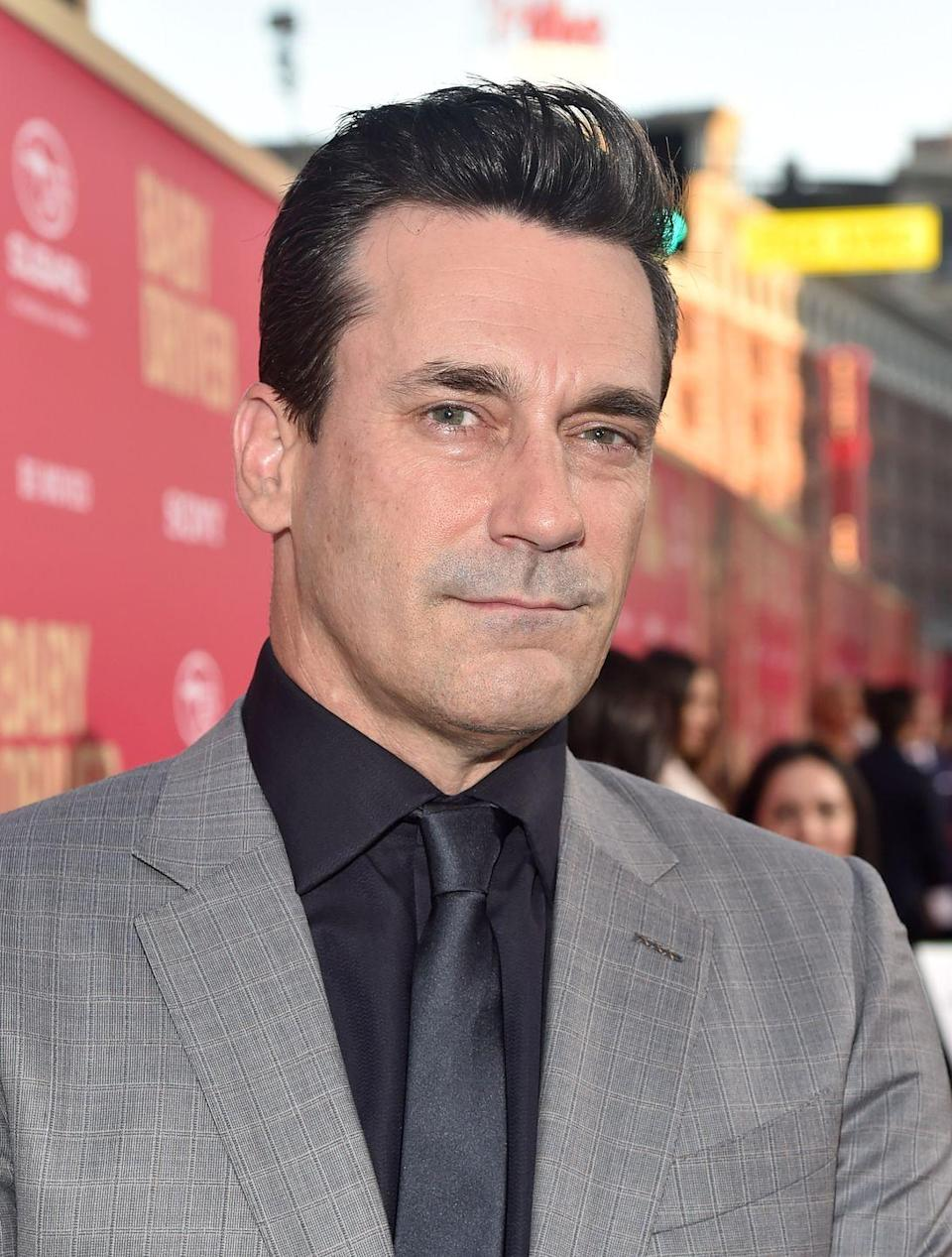 <p>Jon Hamm doesn't usually stray from his Don Drapper hairdo: jet black hair, slicked back. </p>
