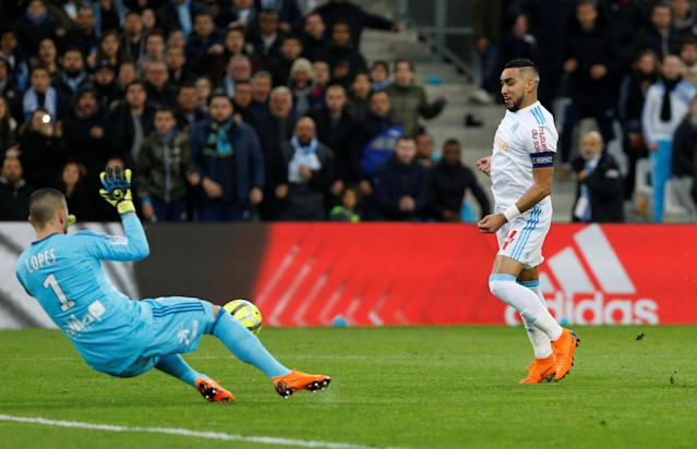 Soccer Football - Ligue 1 - Olympique de Marseille vs Olympique Lyonnais - Orange Velodrome, Marseille, France - March 18, 2018 Marseille's Dimitri Payet shoots at goal REUTERS/Philippe Laurenson