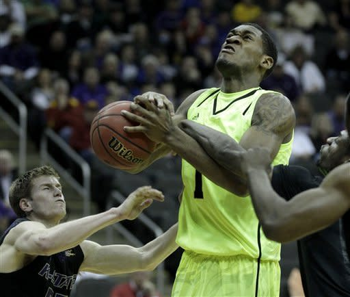 Kansas State's Will Spradling, left, and Jamar Samuels, right, try to steal the ball from Baylor forward Perry Jones III (1) during the first half of an NCAA college basketball first round game in the Big 12 Conference tournament, Thursday, March 8, 2012, in Kansas City, Mo. (AP Photo/Charlie Riedel)