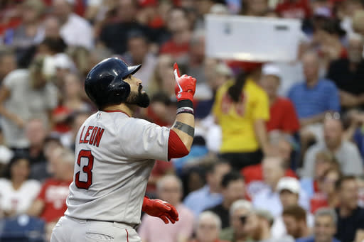 Boston Red Sox's Sandy Leon celebrates after hitting a home run off Philadelphia Phillies starting pitcher Nick Pivetta during the third inning of a baseball game, Tuesday, Aug. 14, 2018, in Philadelphia. (AP Photo/Matt Slocum)