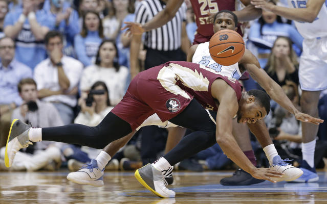 North Carolina's Kenny Williams (24) and Florida State's M.J. Walker chase the ball during the first half of an NCAA college basketball game in Chapel Hill, N.C., Saturday, Feb. 23, 2019. (AP Photo/Gerry Broome)