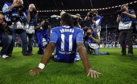 Photographers take pictures of Chelsea's Didier Drogba after their Champions League final soccer match against Bayern Munich at the Allianz Arena in Munich May 19, 2012. REUTERS/Kai Pfaffenbach