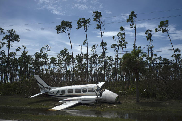 A broken plane lays on the side of a road in the Pine Bay neighborhood in the aftermath of Hurricane Dorian in Freeport, Bahamas, Sept. 4, 2019. (Photo: Ramon Espinosa/AP)