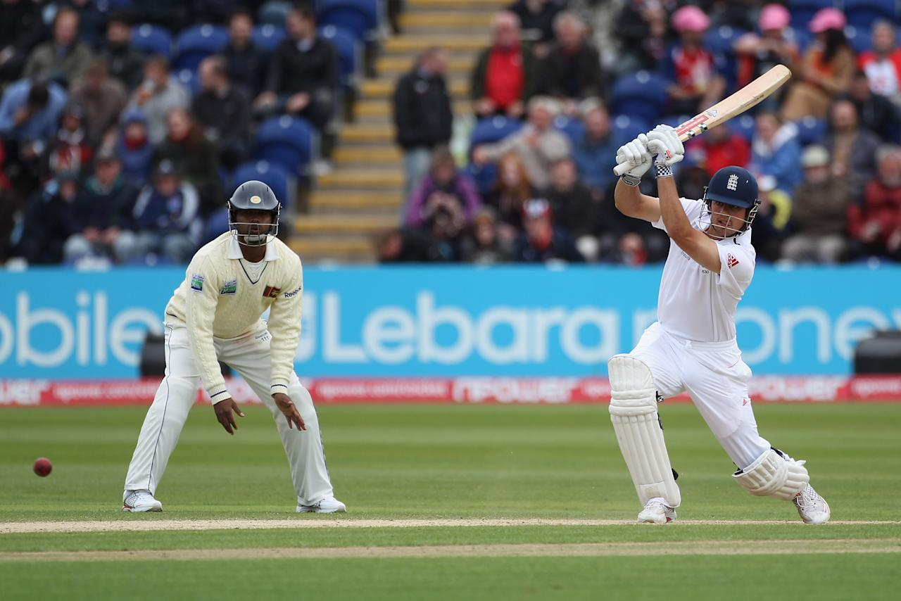 CARDIFF, WALES - MAY 28:  Alastair Cook (R) of England drives to the offside as Tharanga Paranavitana (L) looks on during day three of the 1st npower test match between England and Sri Lanka at the Swalec Stadium on May 28, 2011 in Cardiff, Wales.  (Photo by Michael Steele/Getty Images)