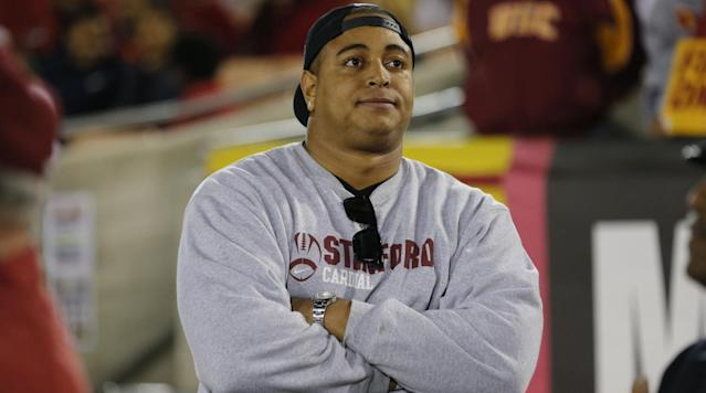 "<p>Former Dolphins offensive lineman Jonathan Martin has been released from custody Friday, one day after <a href=""http://www.12up.com/posts/5986216-high-school-shuts-down-after-former-dolphins-ol-posts-disturbing-instagram-threat"" rel=""nofollow noopener"" target=""_blank"" data-ylk=""slk:posting a disturbing photo"" class=""link rapid-noclick-resp"">posting a disturbing photo</a> on his social media account that forced the closure of a California high school, ESPN's Kyle Bonagura reports.</p><p>Matt Stone of ABC <a href=""https://twitter.com/MattStoneABC/status/967130593187246080"" rel=""nofollow noopener"" target=""_blank"" data-ylk=""slk:reported"" class=""link rapid-noclick-resp"">reported</a> the original news that Martin was taken into custody. </p><p>Michael Balsamo of the Associated Press <a href=""https://apnews.com/b1bbc618c1e64329a0ef29d3649260b8/Jonathan-Martin-detained-by-police-after-Instagram-post?utm_campaign=SocialFlow&utm_source=Twitter&utm_medium=AP"" rel=""nofollow noopener"" target=""_blank"" data-ylk=""slk:reported"" class=""link rapid-noclick-resp"">reported</a> that Martin was questioned and is not under arrest, and a law enforcement official told the AP it was not clear if Martin posted the photo himself.</p><p>Martin, 28, posted a picture Thursday in an Instagram story featuring a gun with the chilling words ""When you're a bully victim & a coward, your options are suicide, or revenge."" The post tagged former Dolphins teammates Richie Incognito and Mike Pouncey, as well as Los Angeles-area Harvard-Westlake high school. Martin graduated from the high school in 2008.</p><p>""Last evening, we learned of an Internet post that mentions Harvard-Westlake by name,"" the school said in a statement as it closed both its campuses. ""Out of an abundance of caution, and because the safety of our students, faculty, and staff is our top priority, we made the decision to close school (Friday). We are working closely with law enforcement and will share more information when we are able.""</p><p>According to the <a href=""http://www.latimes.com/local/lanow/la-me-ln-harvard-westlake-security-risk-20180223-story.html"" rel=""nofollow noopener"" target=""_blank"" data-ylk=""slk:Los Angeles Times"" class=""link rapid-noclick-resp""><em>Los Angeles Times</em></a>, students received a message through the school's Emergency Notification System at 7:14 a.m. PT Friday. Police reported to both campuses.</p><p>The two other accounts tagged in the post appear to belong to men who attended Harvard-Westlake at the same time as Martin. James Dunleavy, the son of former NBA coach Mike Dunleavy, graduated from Harvard-Westlake in 2007 before going to play basketball at USC, and there is a T.J. Taylor who played on the Harvard-Westlake basketball team and graduated in 2007.</p><p>This post comes a week after <a href=""http://time.com/5158678/what-to-know-about-the-active-shooter-situation-at-florida-high-school/"" rel=""nofollow noopener"" target=""_blank"" data-ylk=""slk:19-year-old Nikolas Cruz killed 17 people in Parkland, Fla."" class=""link rapid-noclick-resp"">19-year-old Nikolas Cruz killed 17 people in Parkland, Fla.</a>, at his former school, Marjory Stoneman Douglas High School.</p><p>Martin was drafted by the Dolphins in the second round in 2012 and spent the first two years of his career there. During his second season, it was reported that Marin was being bullied by other members of the Dolphins offensive line. An investigation from lawyer Ted Wells found a <a href=""https://www.si.com/2014/02/14/miami-dolphins-jonathan-martin-richie-incognito-investigation"" rel=""nofollow noopener"" target=""_blank"" data-ylk=""slk:""pattern of harassment"""" class=""link rapid-noclick-resp"">""pattern of harassment""</a> by Miami linemen Incognito, Pouncey and John Jerry. The evidence revealed racist, sexually explicit, homophobic and misogynistic messages were sent to Martin, including a voicemail from Incognito in which Incognito calls Martin the n-word. Incognito was suspended eight games.</p><p>Martin played one more year in the NFL with the 49ers after leaving the Dolphins. After that season, a back injury <a href=""https://www.si.com/nfl/2015/07/27/dolphins-49ers-jonathan-martin-retires"" rel=""nofollow noopener"" target=""_blank"" data-ylk=""slk:pushed Martin to retire"" class=""link rapid-noclick-resp"">pushed Martin to retire</a>. The summer after retiring, Martin revealed he <a href=""https://www.si.com/nfl/2015/08/26/jonathan-martin-depression-suicide-attempt"" rel=""nofollow noopener"" target=""_blank"" data-ylk=""slk:attempted suicide multiple times during his career"" class=""link rapid-noclick-resp"">attempted suicide multiple times during his career</a>. It was also reported that he was <a href=""https://www.si.com/nfl/2015/08/27/jonathan-martin-memoir-book-nfl-career"" rel=""nofollow noopener"" target=""_blank"" data-ylk=""slk:working on a memoir"" class=""link rapid-noclick-resp"">working on a memoir</a> that summer.</p>"
