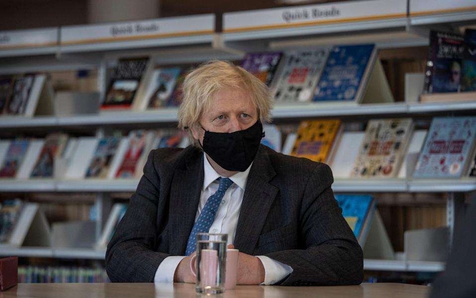 Prime Minister Boris Johnson meets with teachers in the library during a visit to Sedgehill School in Lewisham - PA
