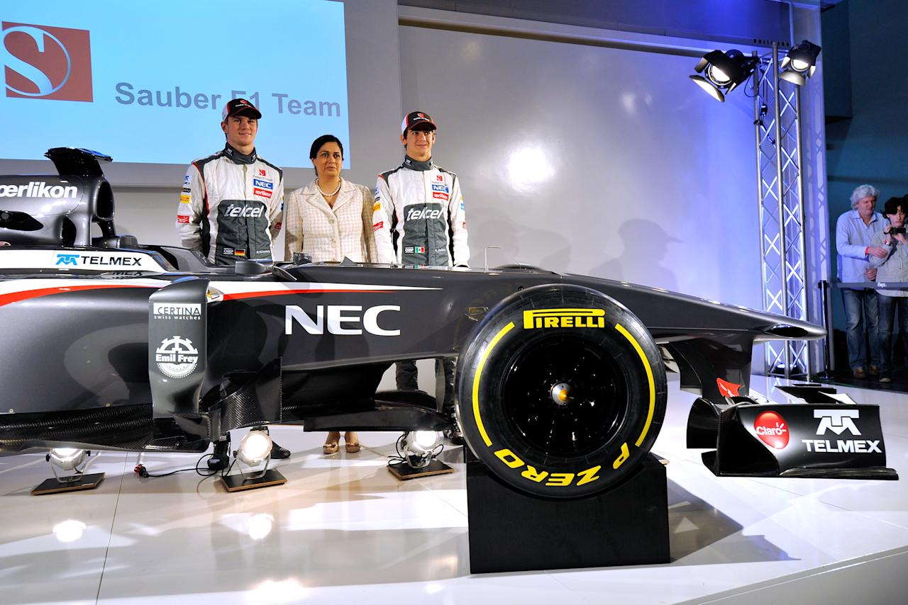 HINWIL, SWITZERLAND - FEBRUARY 02:  Sauber F1 driver Nico Hulkenberg of Germany, Sauber Team Principal Monisha Kaltenborn, and Sauber F1 driver Esteban Gutierrez of Mexico unveil the Sauber C32-Ferrari new car for the 2013 Formula 1 season, during the launch at the Sauber Motorsport AG on February 2, 2013 in Hinwil, Switzerland.  (Photo by Harold Cunningham/Getty Images)