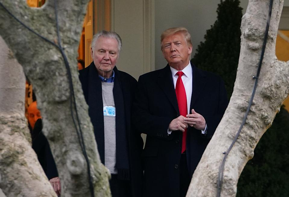 US President Donald Trump (R) stands with actor Jon Voight outside the Oval Office before departing from the South Lawn of the White House in Washington, DC on January 28, 2020
