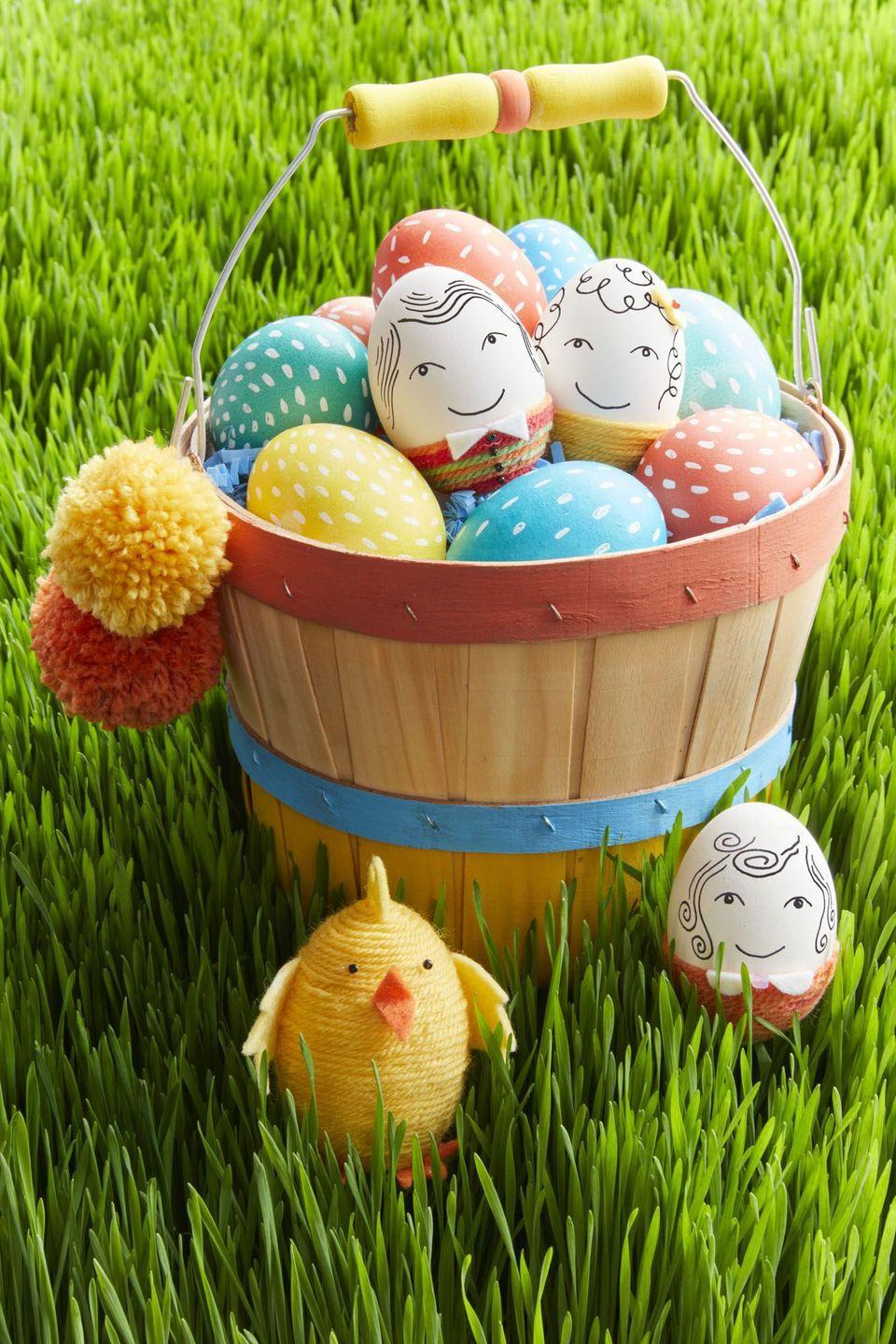 """<p>Turn a bushel basket into a cheery catchall for Easter loot by adding a few bright stripes of paint and a pair of homemade pompoms. Add colorful <a href=""""https://www.womansday.com/home/crafts-projects/g2216/easter-eggs/"""" rel=""""nofollow noopener"""" target=""""_blank"""" data-ylk=""""slk:Easter eggs"""" class=""""link rapid-noclick-resp"""">Easter eggs</a> inspired by chicks and cute characters for some extra festive flair.</p><p><strong>Best dressed:</strong> Draw a face and hair on a ceramic egg. Wrap the bottom third of egg in thick yarn (tip: work from the middle down) and secure by brushing on white craft glue in sections. Create details like collars, bows, and buttons with felt and beads.</p><p><strong>Dashing Design Egg:</strong> Follow tradition and dye your eggs first. Once dry, draw a series of short lines with a white paint marker.</p><p><strong>Fuzzy Chick:</strong> Wrap a ceramic or wooden egg in yarn (tip: start at the top and work down) and secure by brushing on white craft glue in sections as you work. Use templates to make felt wings, feet, beak, and hair, and attach with glue. Glue on small black-bead eyes.</p><p><strong><strong><em><a href=""""https://www.womansday.com/home/crafts-projects/a18837631/easter-egg-templates/"""" rel=""""nofollow noopener"""" target=""""_blank"""" data-ylk=""""slk:Get the templates here."""" class=""""link rapid-noclick-resp"""">Get the templates here.</a></em></strong></strong></p><p><strong><a class=""""link rapid-noclick-resp"""" href=""""https://www.amazon.com/Elmers-Craft-Bond-Tacky-Clear/dp/B000LNR27U/?tag=syn-yahoo-20&ascsubtag=%5Bartid%7C10070.g.1751%5Bsrc%7Cyahoo-us"""" rel=""""nofollow noopener"""" target=""""_blank"""" data-ylk=""""slk:SHOP CRAFT GLUE"""">SHOP CRAFT GLUE</a></strong></p>"""