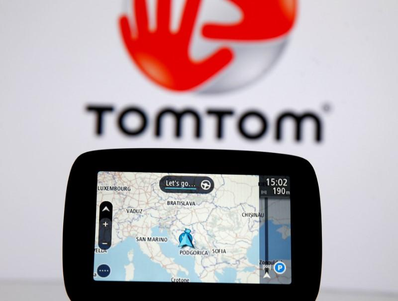 FILE PHOTO: TomTom navigation are seen in front of TomTom displayed logo in this illustration taken