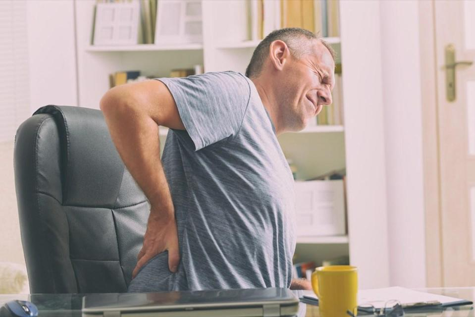 Man with back pain from sleeping wrong