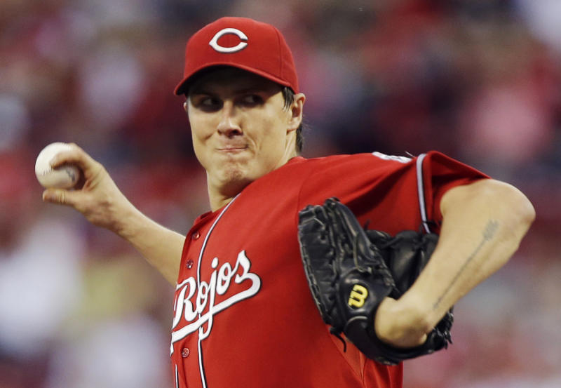 Cincinnati Reds starting pitcher Homer Bailey throws against the Pittsburgh Pirates during the first inning of a baseball game on Friday, Sept. 27, 2013, in Cincinnati. (AP Photo/Al Behrman)