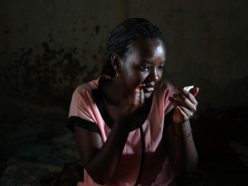 Angel, who declined to let us use her first or last name (Angel is her middle name), puts on make-up before going to church