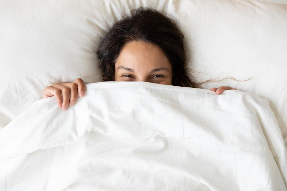 These weighted blankets won't <i>weigh</i> down your wallet— they're on sale for Prime Day 2020. (Photo: fizkes via Getty Images)