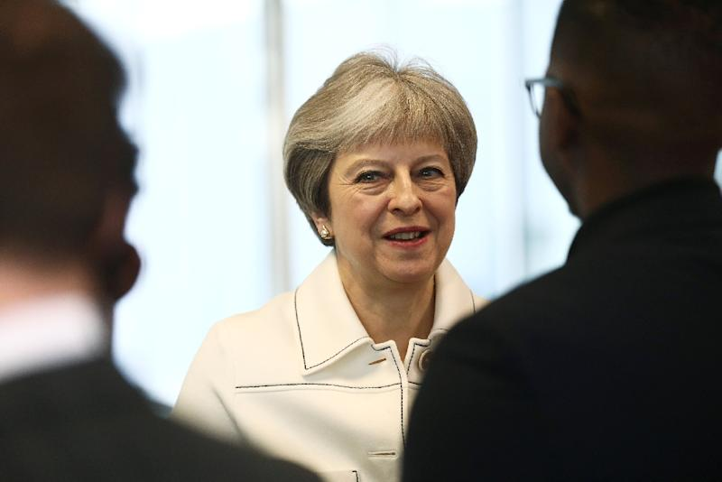 British Prime Minister Theresa May and French President Emmanuel Macron are facing anger from lawmakers for conducting air strikes with the United States in Syria in their first major military action since coming to power (AFP Photo/SIMON DAWSON)