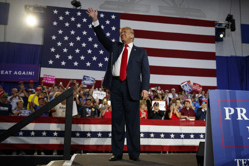 President Donald Trump waves to the cheering crowd as he arrives to speak at a rally at Olentangy Orange High School in Lewis Center, Ohio, Saturday, Aug. 4, 2018. (AP Photo/Carolyn Kaster)
