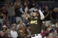 San Diego Padres' Eric Hosmer reacts after hitting a home run during the fifth inning against the Arizona Diamondbacks in a baseball game Friday, Aug. 17, 2018, in San Diego. (AP Photo/Gregory Bull)