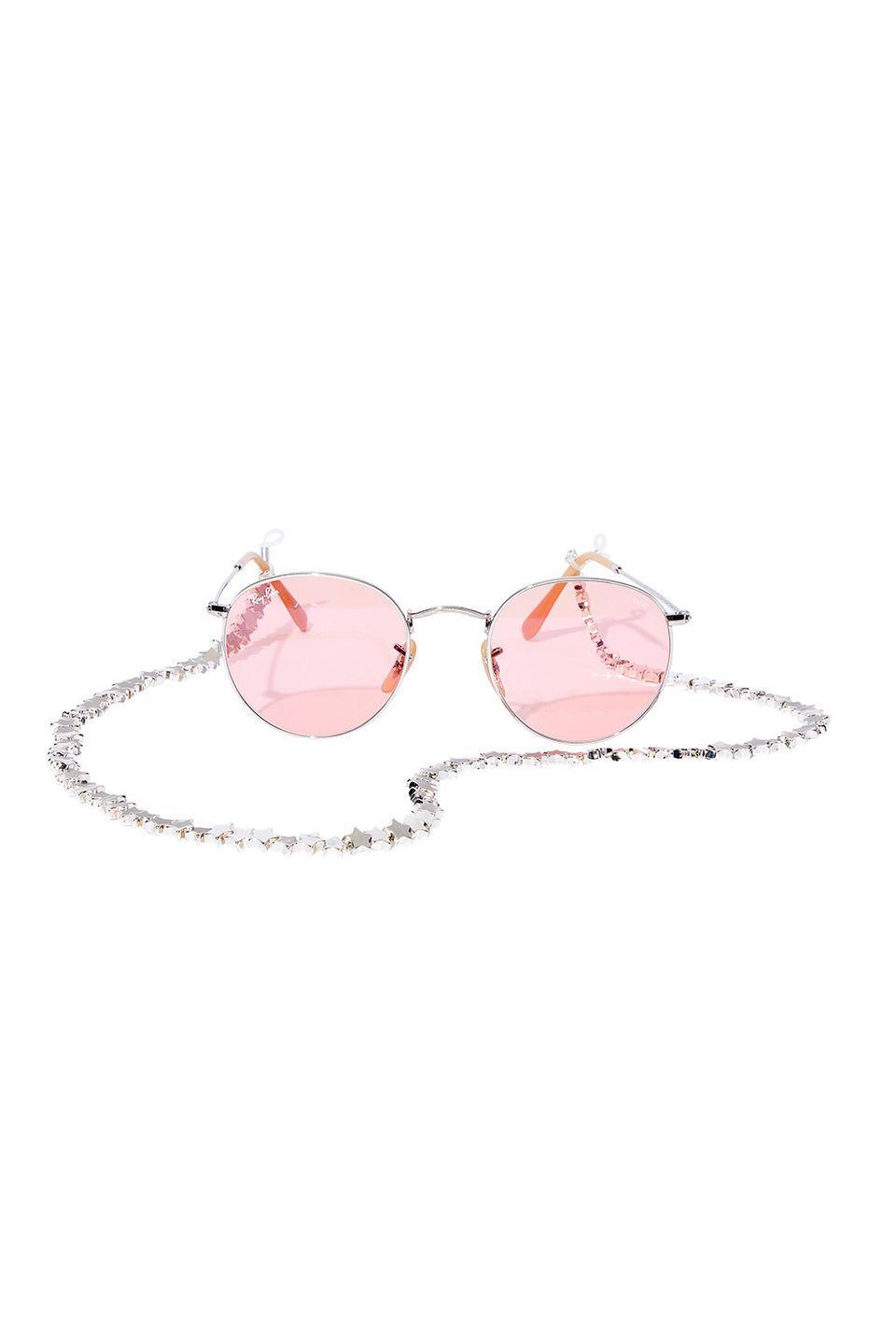 """<p>The combo of your dreams for a late summer concert or just hanging out after school. </p><p>Ray-Ban sunglasses, $183, <a href=""""https://www.ray-ban.com/usa"""" rel=""""nofollow noopener"""" target=""""_blank"""" data-ylk=""""slk:ray-ban.com"""" class=""""link rapid-noclick-resp"""">ray-ban.com</a></p><p>Tuleste sunglasses chain, $50, <a href=""""https://tuleste.com/"""" rel=""""nofollow noopener"""" target=""""_blank"""" data-ylk=""""slk:tuleste.com"""" class=""""link rapid-noclick-resp"""">tuleste.com</a></p>"""