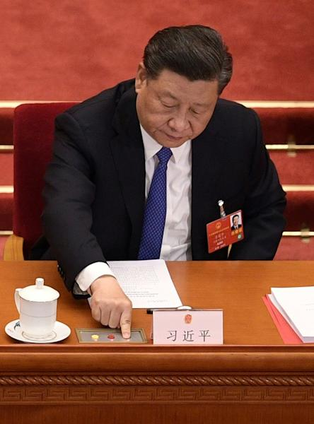Chinese President Xi Jinping votes on the plan to produce a law banning secession in Hong Kong