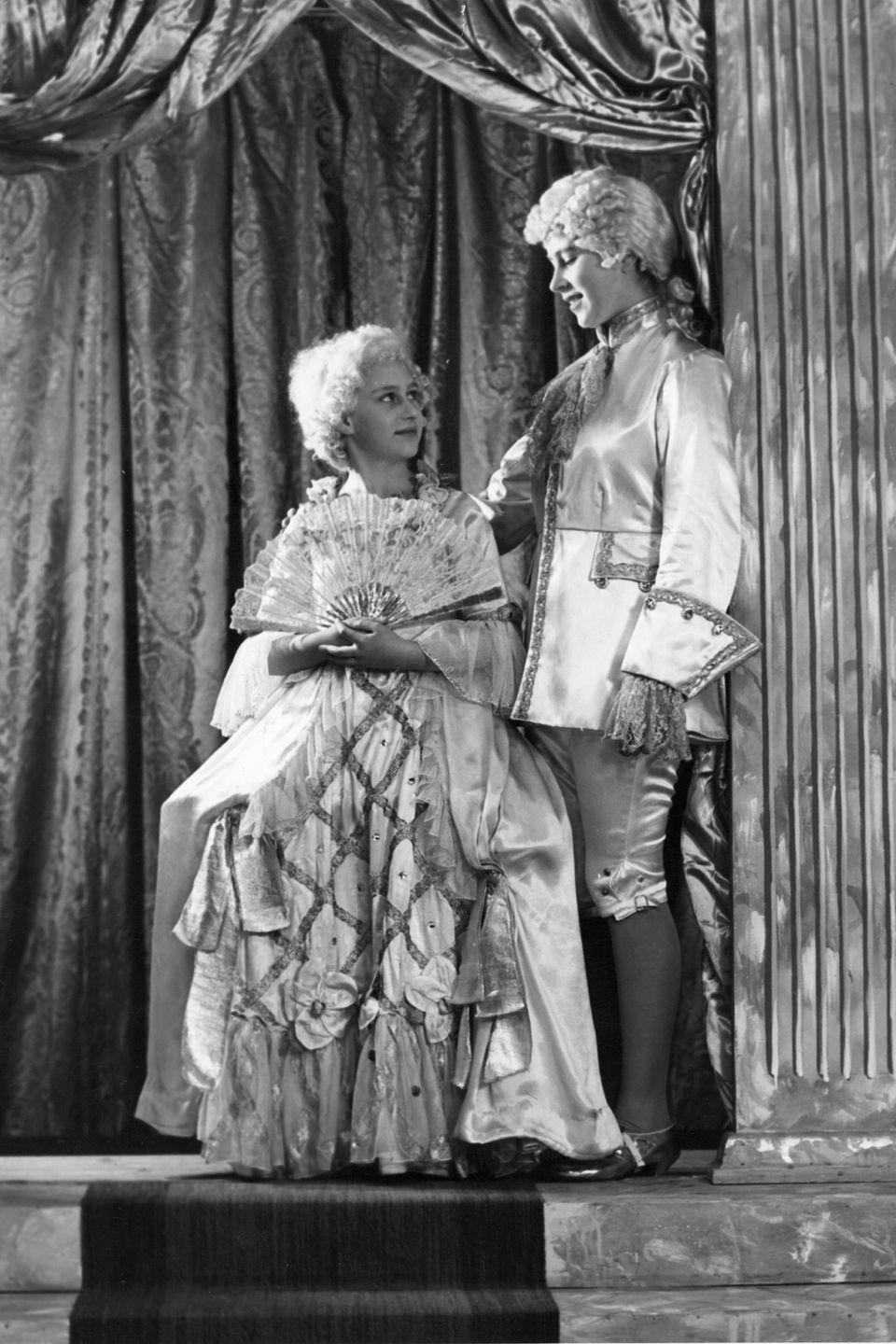 "<p>Princess Elizabeth (now Queen Elizabeth II) and Princess Margaret dressed in costume for a performance of ""Cinderella"" at Windsor Castle.</p>"