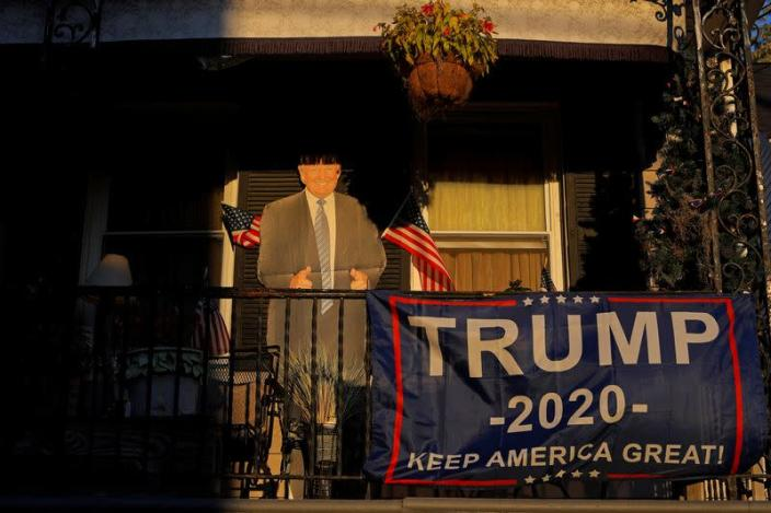 A cutout of U.S. President Donald Trump stands on a balcony in Nazareth