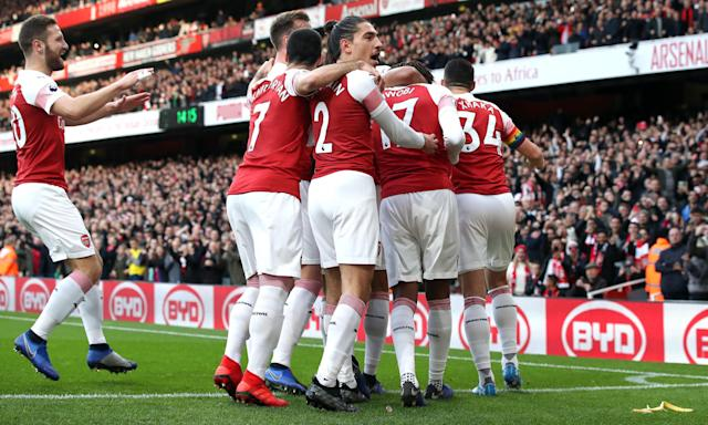Arsenal players celebrate Pierre-Emerick Aubameyang's opening goal as a banana skin is thrown on to the pitch.