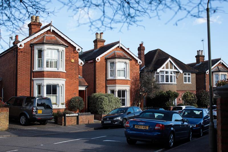 WEYBRIDGE, ENGLAND - FEBRUARY 12: A row of houses stand on a residential street on February 12, 2018 in Weybridge, United Kingdom. Surrey County Council have approved the highest possible increase in council tax as they face a reported £105M gap in their finances over the next year. Nearly all other local authorities across the country also plan to increase council tax amid financial concerns. (Photo by Jack Taylor/Getty Images)