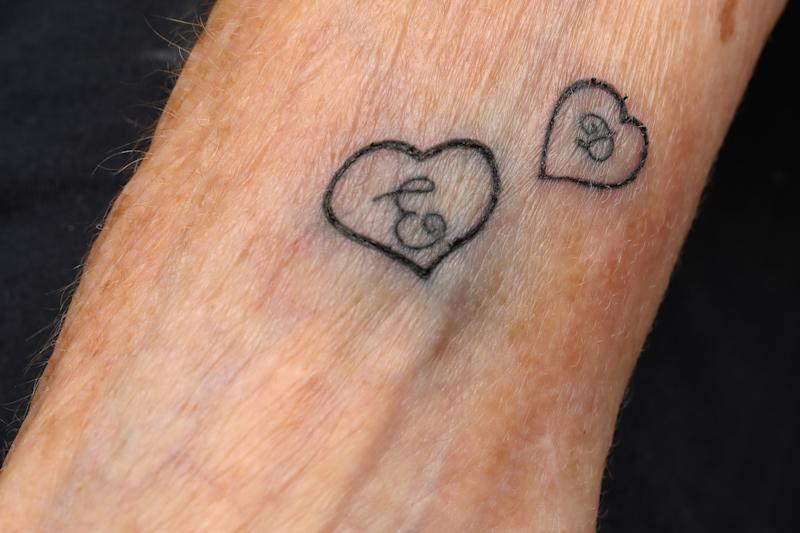 Hilda West got the initials of her husband and son tattooed on her wrist (Picture: SWNS)