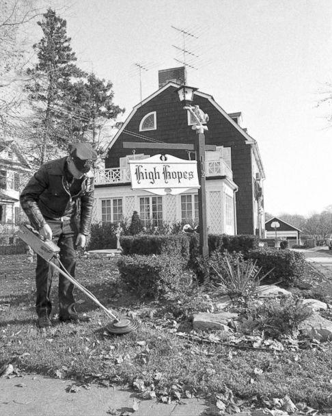 PHOTO: Suffolk County policeman uses mine detector as he sweeps through dead leaves on lawn of Ronald DeFeo's 12-room, $75,000 Dutch colonial home in Amityville. (Dan Godfrey/NY Daily News Archive via Getty Images)