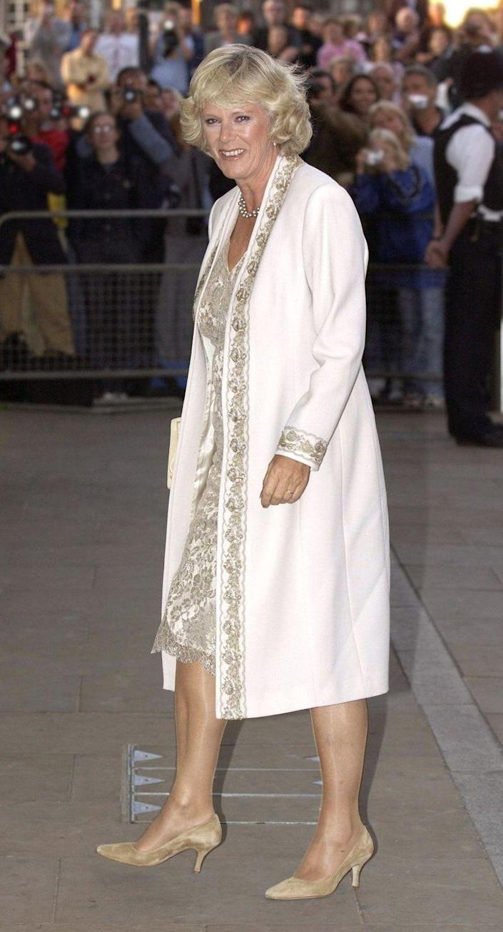 <p>Camilla attended a gala for Prince Charles's charity, The Prince's Trust, at Shakespeare's Globe Theatre in London wearing this metallic lace sheath dress with cream dress coat. </p>